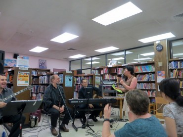 Maninakis Performed at East Flushing Library