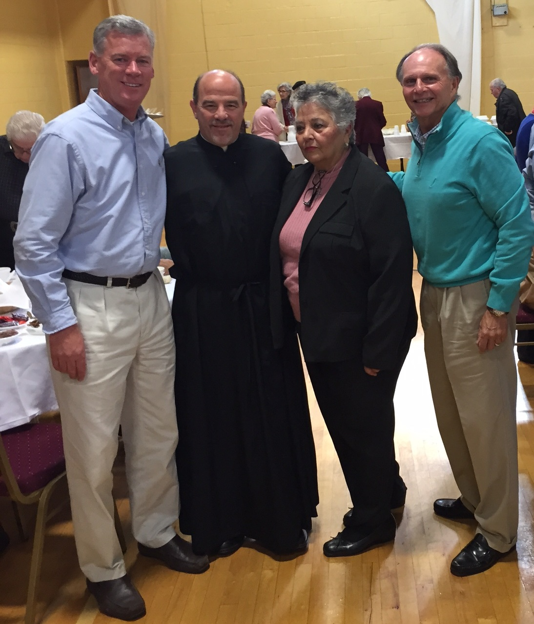 Tom McGarrigle, Rev. Father Chris Kontos, Christina Zografakis, Bill Adolph .  Guests of St Luke's Church for the Senior Luncheon