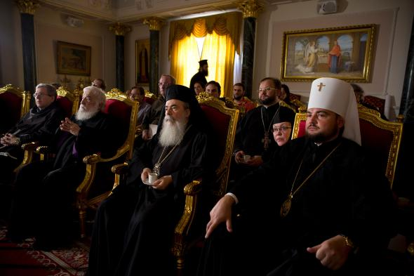 Church leaders listen to an update on the renovation work from Dr. Antonia Moropoulou, leader of the restoration team. PHOTOGRAPH BY ODED BALILTY, AP FOR NATIONAL GEOGRAPHIC