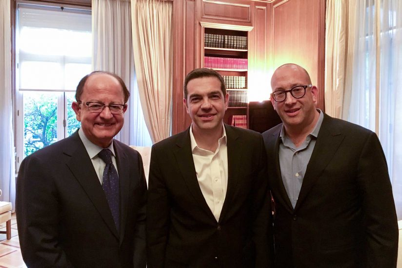 The professor of history and accounting and USC President C. L. Max Nikias present book to prime minister of Greece
